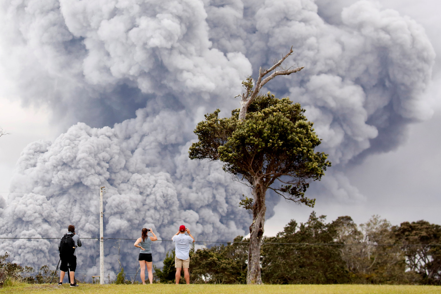People watch ash rise from Kilauea Volcano in Hawaii May 15.