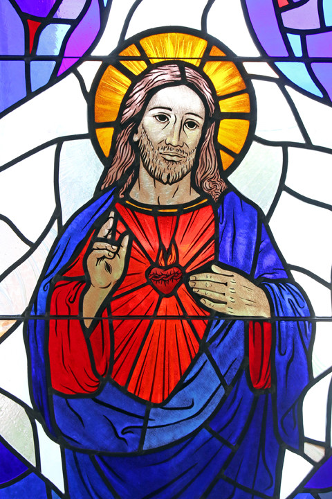 LOVING HEART—The Sacred Heart of Jesus is depicted in a stained-glass window at St. Patrick Church in Smithtown. The feast of the Sacred Heart of Jesus is June 8 this year.