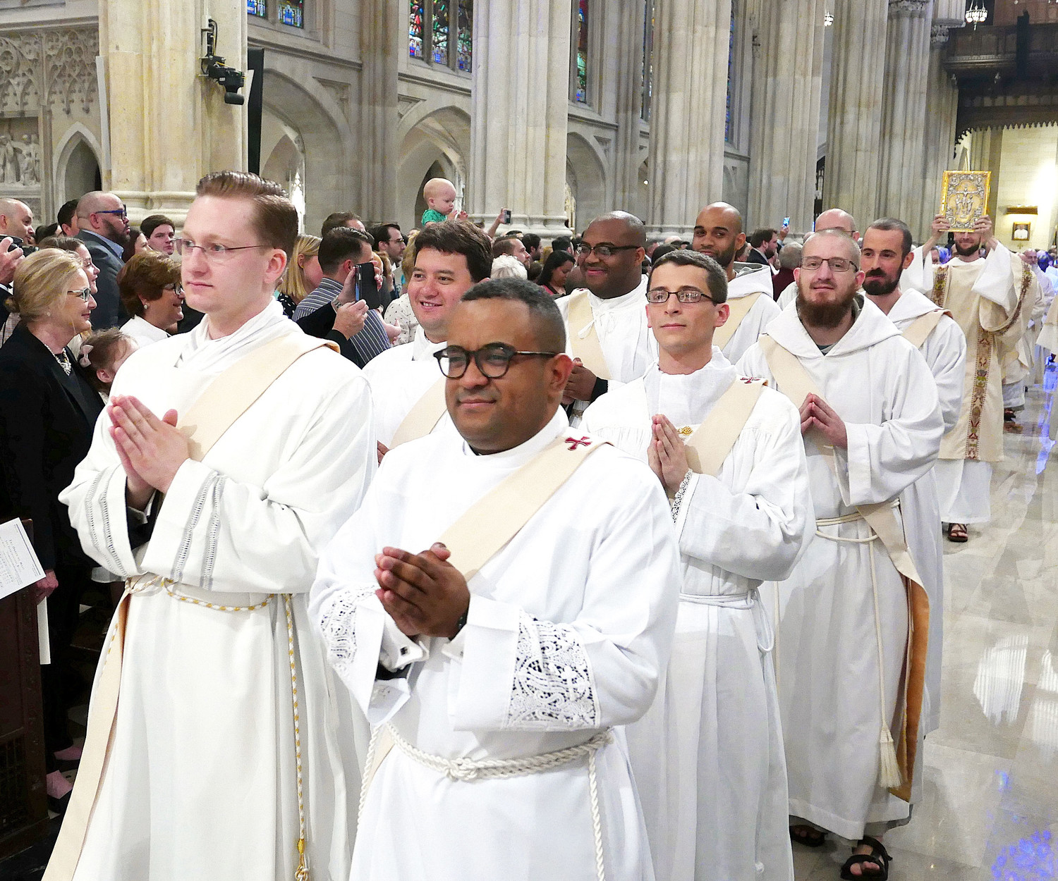 As the Mass of Ordination begins, the nine men who were ordained to the priesthood by Cardinal Dolan on May 26 process up the center aisle of St. Patrick's Cathedral. Leading the way were Father Michael Connolly and Father Osvaldo Hernandez.