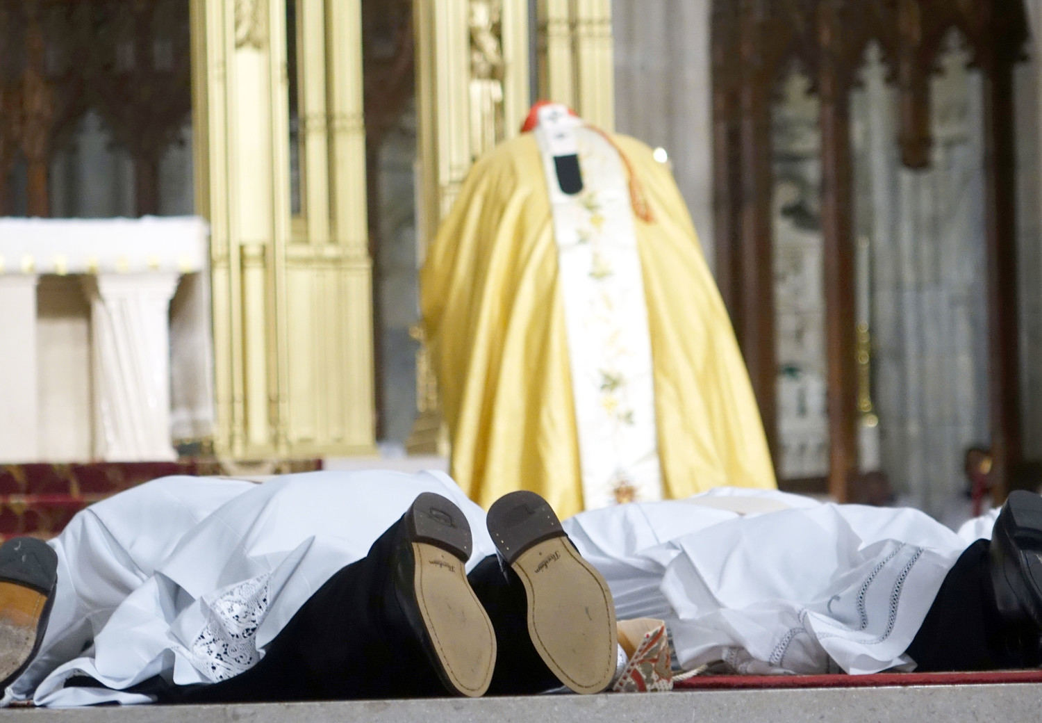 The candidates lay prostrate on the floor of the sanctuary as the Litany of Supplication is sung.