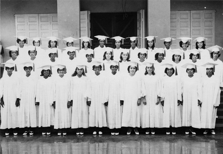 HIGH SCHOOL MEMORY—Members of the class of 1968 at Pallotti High School in Belize City, Belize, pose in their caps and gowns. Seven of the graduates, along with one of their teachers and other guests, enjoyed a 50th anniversary reunion June 16 at St. Patrick's Cathedral, where they attended Mass and held a reception afterward.