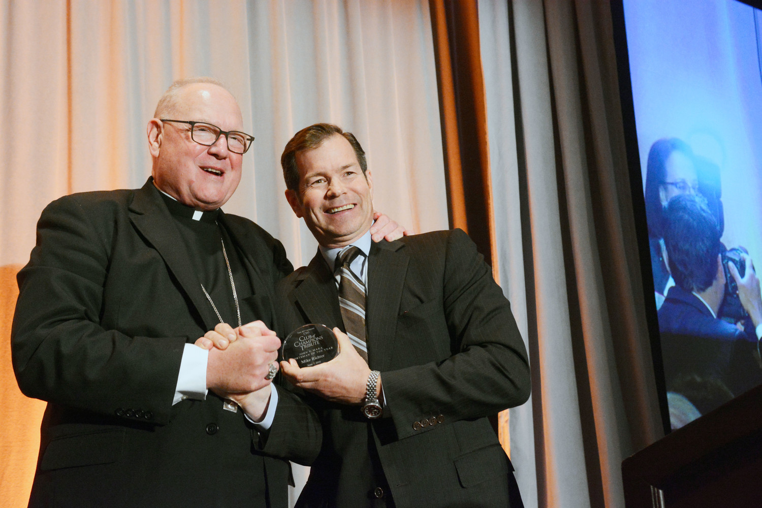 Mike Richter, a member of the 1994 Stanley Cup champion New York Rangers, receives the John V. Mara Sportsman of the Year Award from Cardinal Dolan at the 82nd annual CYO Club of Champions Tribute at the InterContinental New York Barclay in Manhattan June 7. Richter, now president of Brightcore Energy in Armonk, was honored with attorney Martin Edelman, Gold Medal winner, and philanthropist Mark D'Urso, Terence Cardinal Cooke Humanitarian Award winner.
