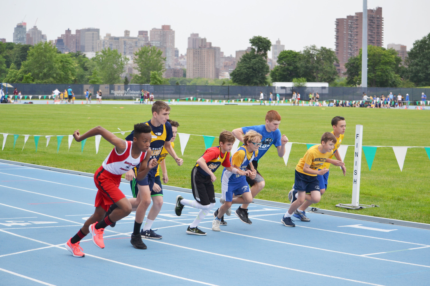Runners take off from the starting line in an eighth-grade race at the Archdiocesan CYO Track and Field Championships at Icahn Stadium on Randalls Island in Manhattan June 10. St. Charles of Staten Island won the boys and girls team championships.