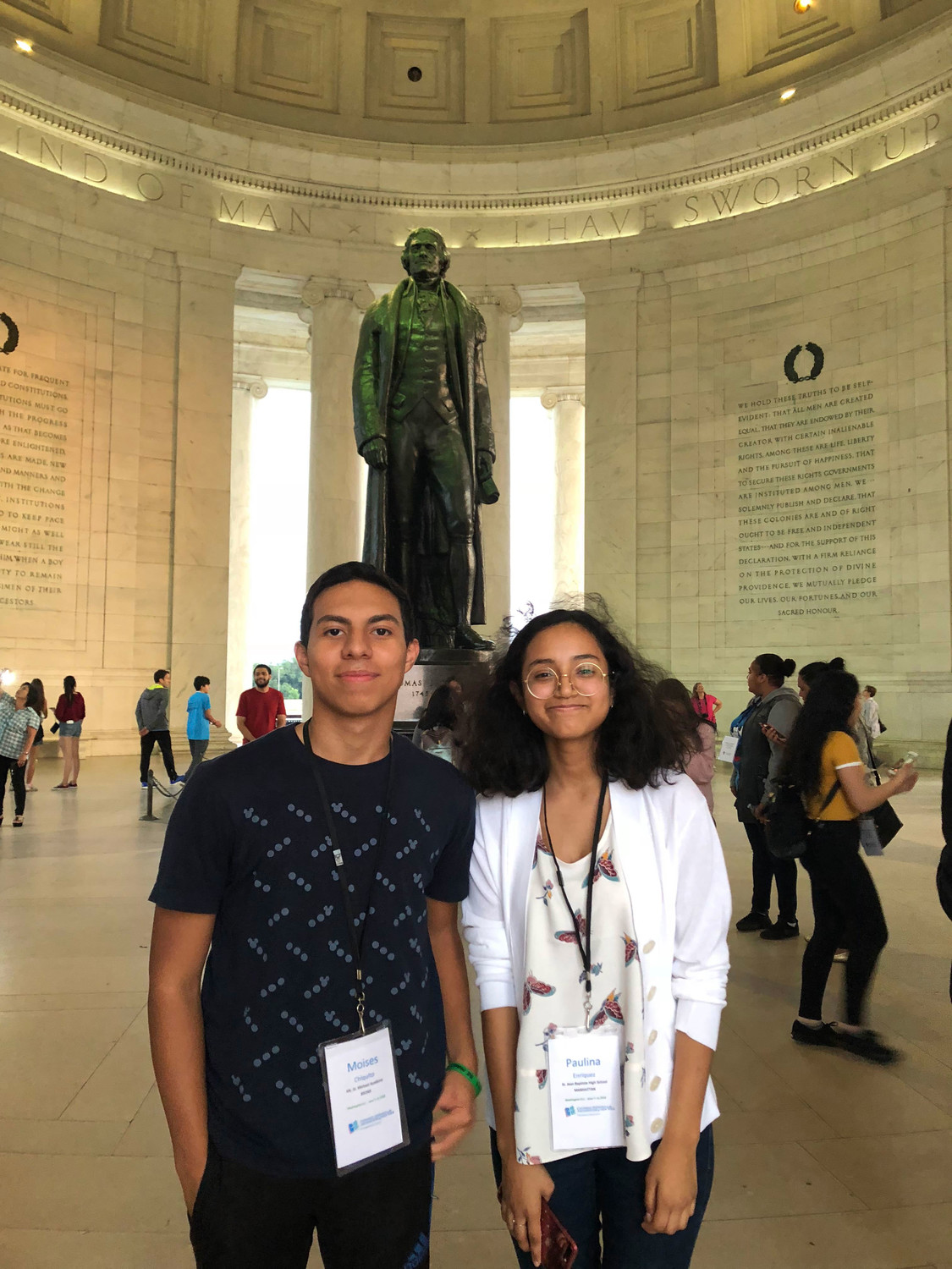 Moises Chiquito of Mount St. Michael Academy in the Bronx, left, and Paulina Enriquez of St. Jean Baptiste High School in Manhattan smile in front of the Thomas Jefferson statue at the Jefferson Memorial.