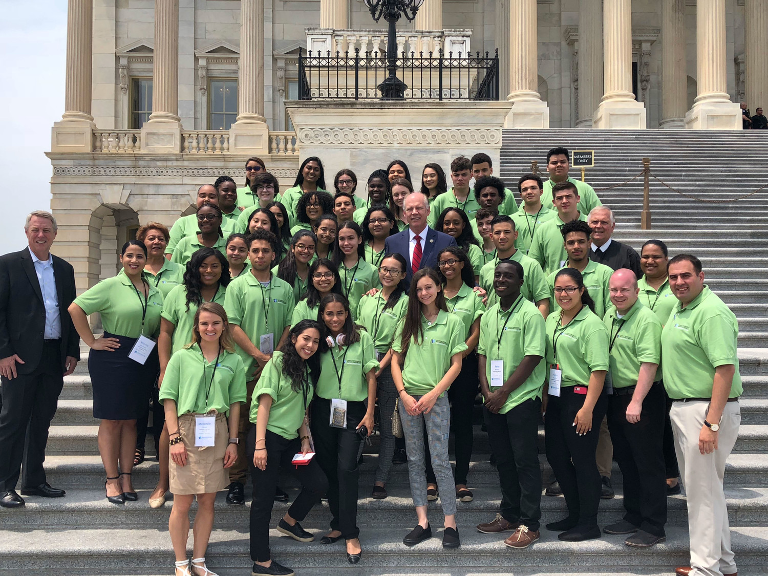 Students and archdiocese education officials stand on the steps of the U.S. Capitol for a photo with Dr. Timothy J. McNiff, superintendent of schools, left, and Rep. Dan Donovan, R-NY, center, during a trip for 40 Catholic high school students to Washington, D.C., June 7 and 8.