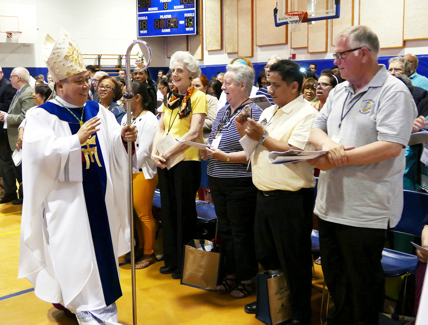 Archbishop Bernardito Auza, apostolic nuncio and permanent observer of the Holy See to the United Nations, far left, greets New York Catholic Bible Summit-goers June 16 at Cathedral High School in Manhattan.