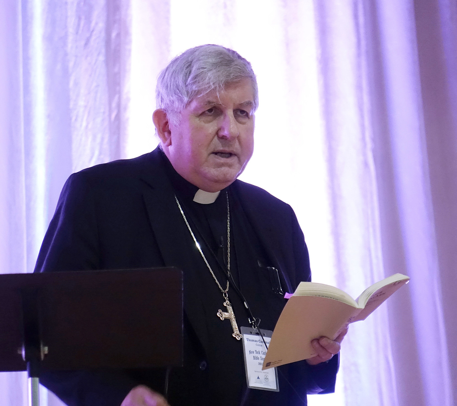 Cardinal Thomas Collins of Toronto, top right, delivered the Bible summit's keynote address in English.
