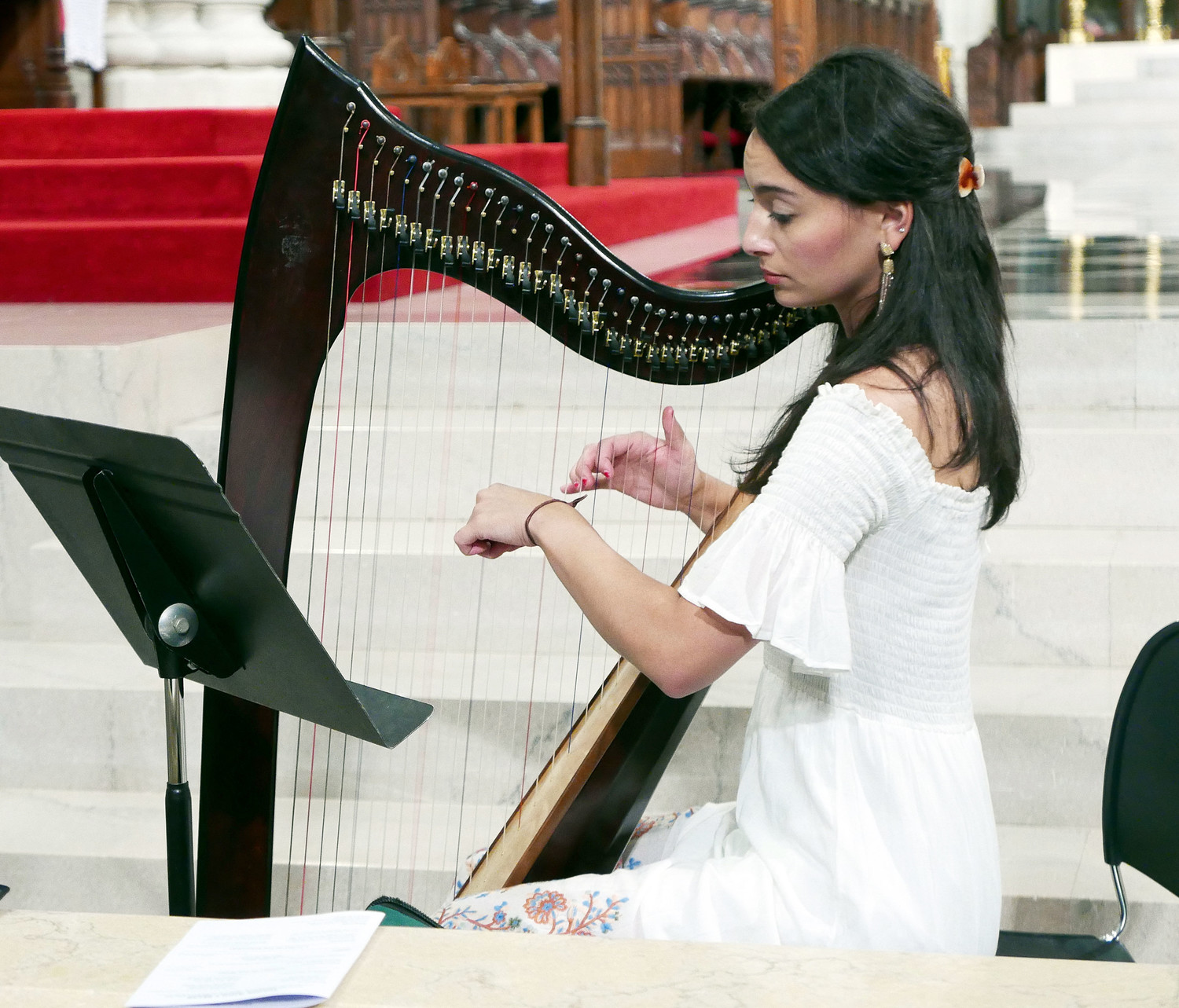 Tess Miller plays the harp at a Mass for young adults celebrated by Cardinal Dolan at St. Patrick's Cathedral June 20.
