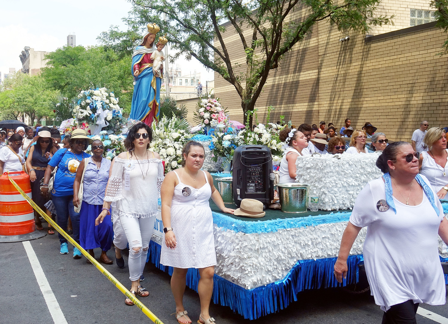 The statue of the Blessed Mother is carried on a float in the procession.