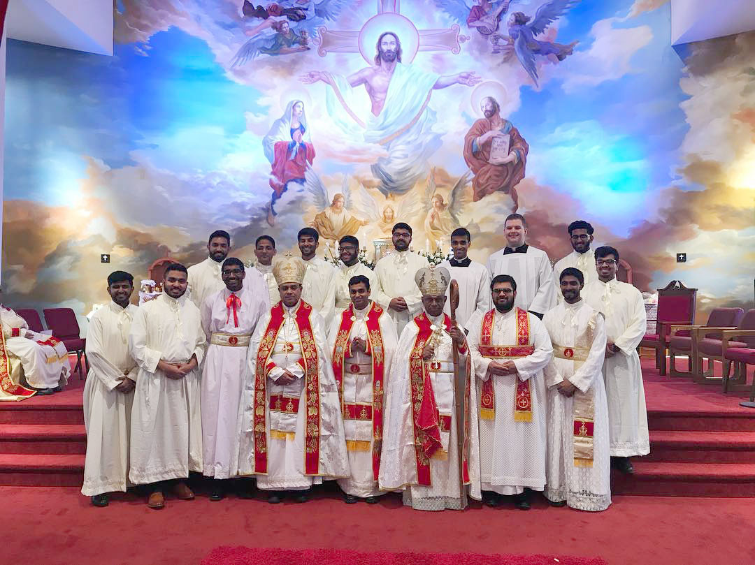 CALLED—Father Kevin Mundackal, center, following his ordination May 5. To his left is Auxiliary Bishop Mar Joy Alappat and to his right is Bishop Mar Jacob Angadiath, both of the St. Thomas Syro-Malabar Catholic Diocese of Chicago. Far right in first row is Father Rajeev Valiyaveettil Philip, ordained June 2.