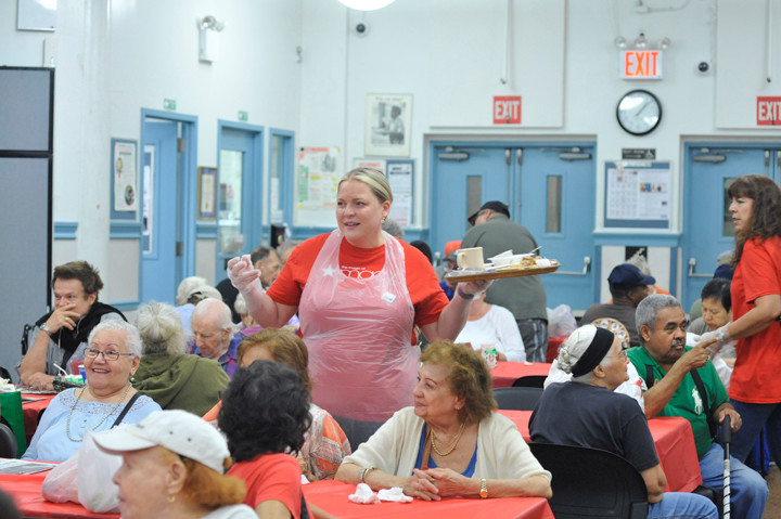 Members of Macy's leadership team assisted with the lunch for seniors citizens at the Encore Senior Center at St. Malacy's parish in Manhattan.