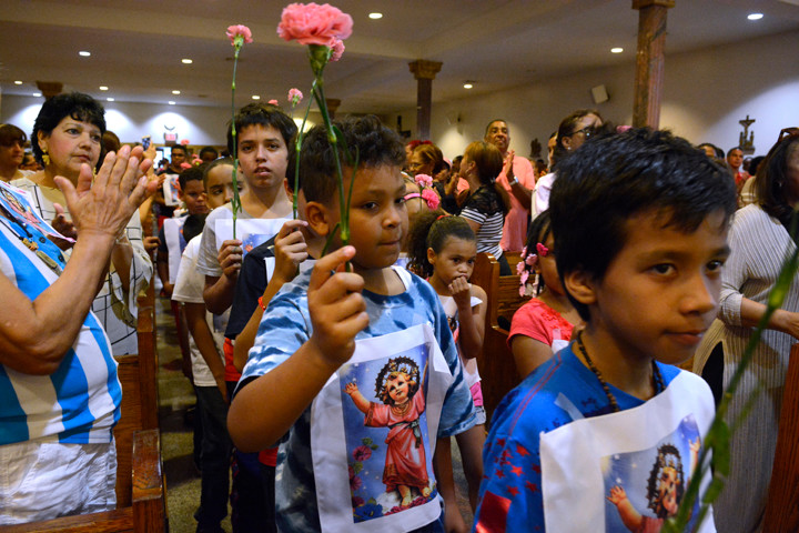 Each child wore an image of Divino Nino (Divine Child Jesus) over his or her shirt and was given a carnation, which was blessed and taken home.