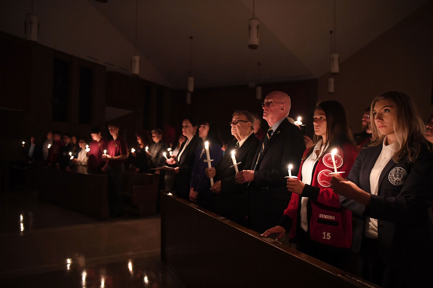 Participants hold lighted candles at the annual Eve of Remembrance in Our Lady of Pity Church on Staten Island last September. This year's vigil marking the 17th anniversary of 9/11 will be held at Our Lady of Pity on Monday, Sept. 10, at 7 p.m.