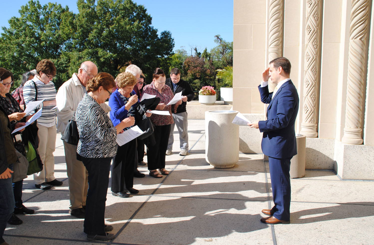 Daniel Frascella, director of the archdiocesan Office of Adult Faith Formation, leads pilgrims in prayer on the front steps of the Basilica of the National Shrine of the Immaculate Conception in Washington, D.C., in October 2016.
