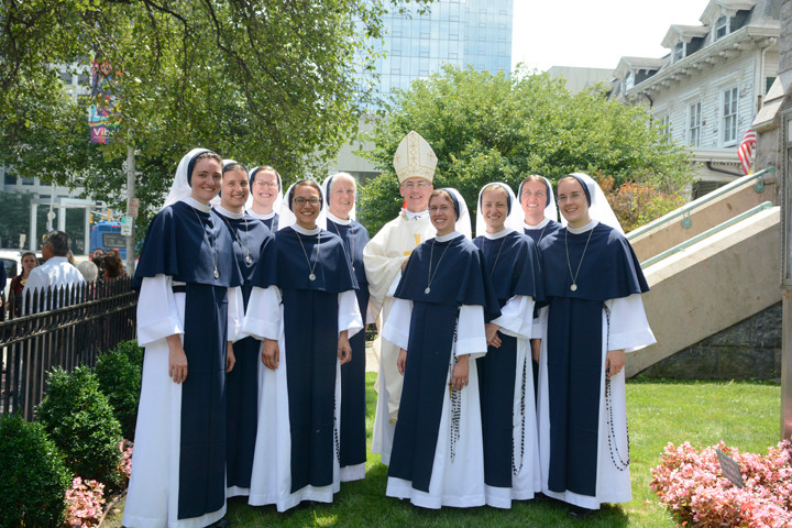 DEVOTED—Clockwise, from top: Archbishop Charles Brown shares a joyous moment with the Sisters of Life after eight made their solemn vows on Aug. 6: from left, Sister Faustina Maria Pia, S.V.; Sister Mariana Benedicta, S.V.; Sister Monica Marie, S.V.; Sister Gianna Maria, S.V. (dark-rimmed glasses); Mother Agnes Mary Donovan, S.V., superior general; Sister Talitha Guadalupe, S.V. (in front of Archbishop Brown); Sister Maria Regina Immaculata, S.V.; Sister Cecilia Rose, S.V. and, at far right, Sister Marie Veritas, S.V.