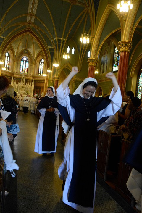 Showing their joy during the recessional are Sister Faustina Maria Pia, S.V., front, and Sister Mariana Benedicta, S.V.