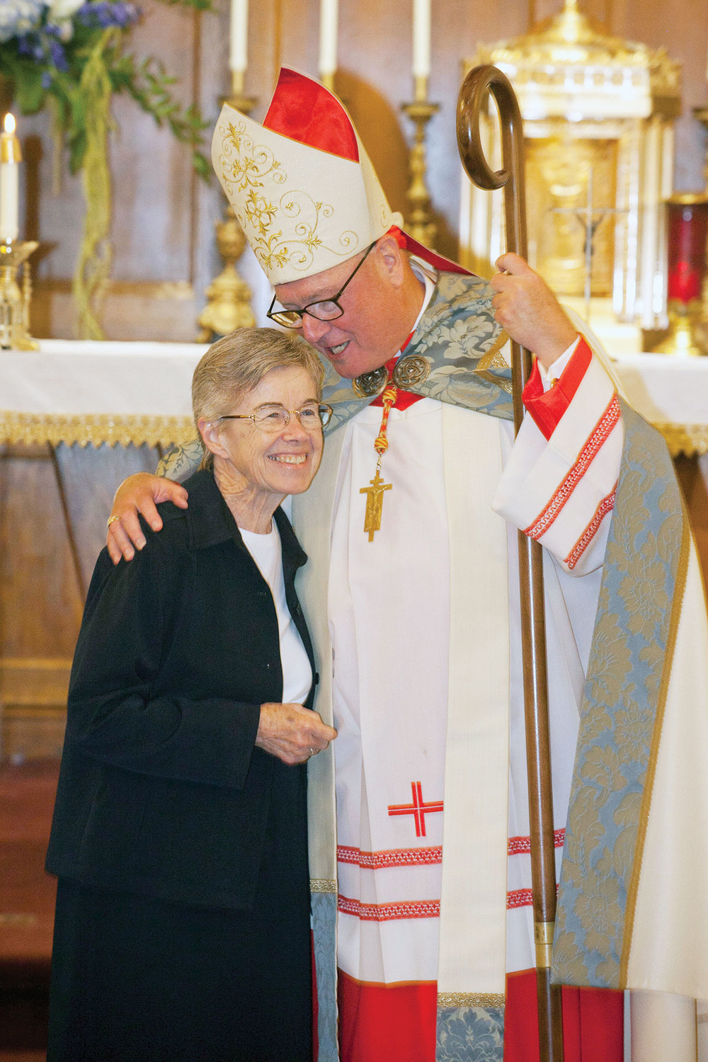 Cardinal Dolan congratulates Sister Kathleen Treanor, P.V.B.M., who renewed her vows to celebrate 60 years with the Sisters of the Presentation of the Blessed Virgin Mary.