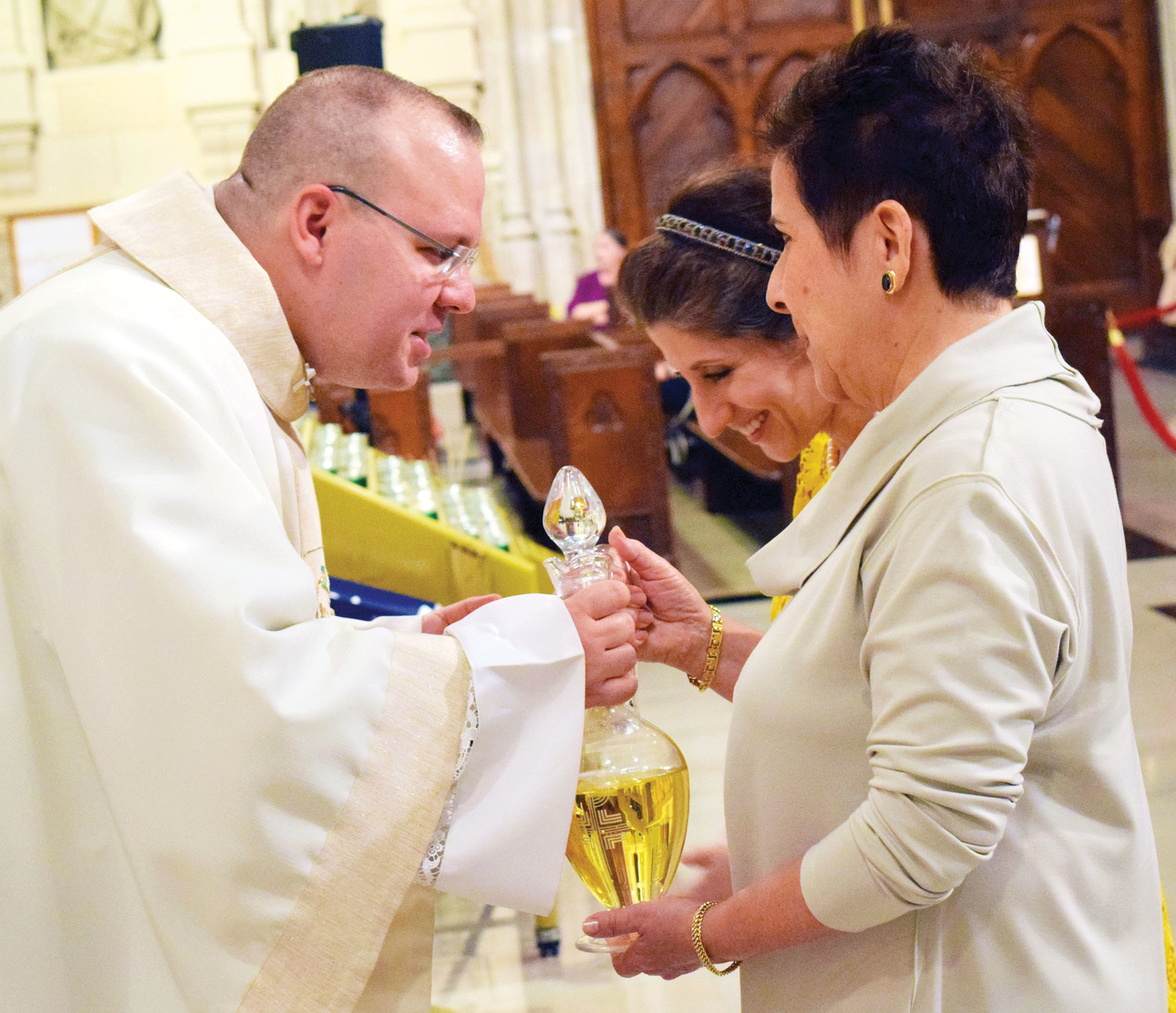 Father Barrios, who was born and raised in Cuba, receives the offertory gifts.