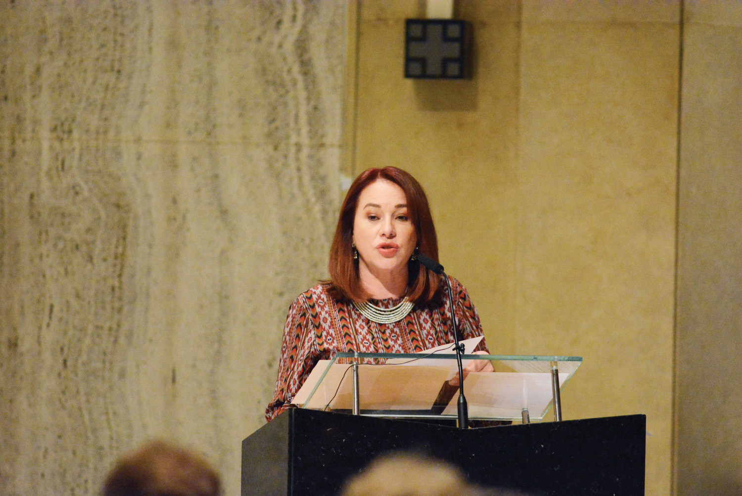 María Fernanda Espinosa Garcés of Ecuador, president of the 73rd Session of the General Assembly, delivers remarks at the prayer service. Known as the United Nations parish, Holy Family is located near the U.N. headquarters.