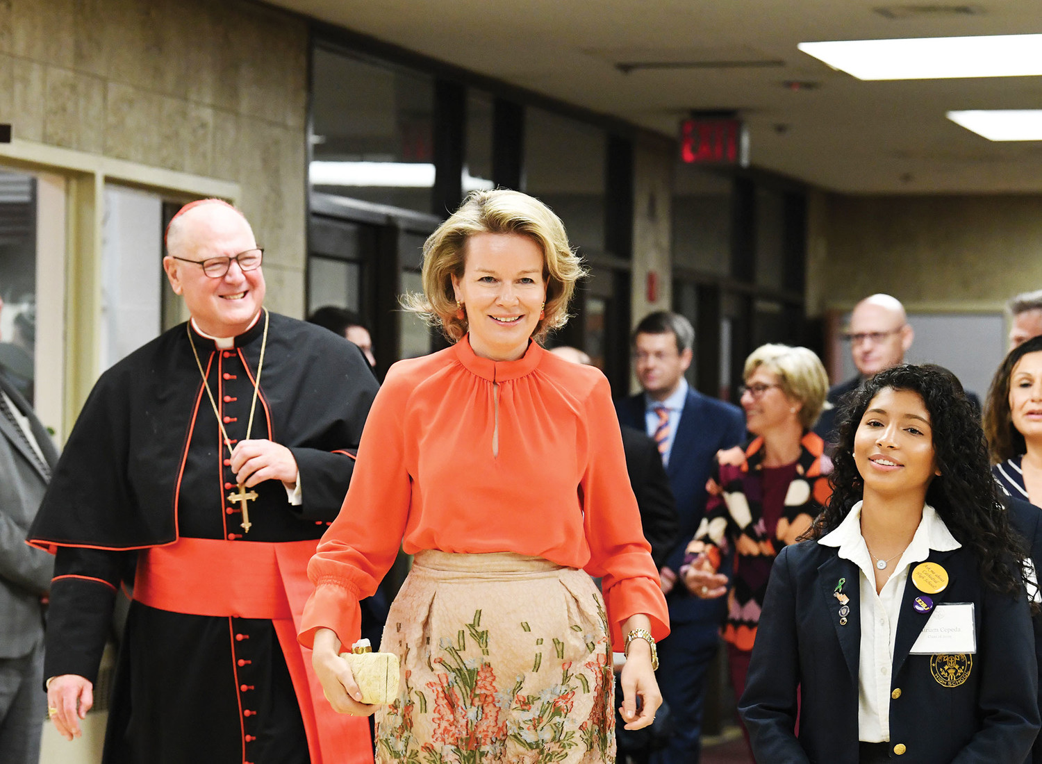 Her Majesty Queen Mathilde of Belgium walks with Cardinal Dolan through the main lobby of Cathedral High School in Manhattan on her way to the gymnasium where she was greeted by the school's 500 students, and teachers and administrators Sept. 25.
