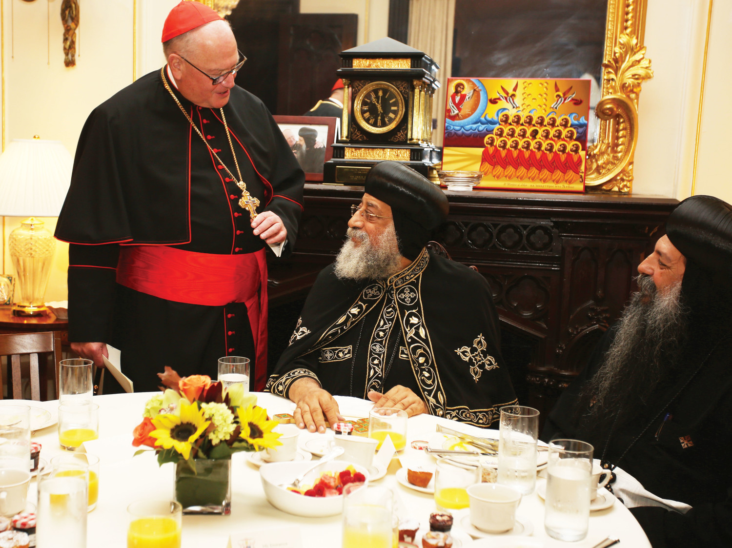 Cardinal Dolan speaks with Coptic Orthodox Christian Pope Tawadros II, center, and Bishop David of the Coptic Orthodox Diocese of New York and New England during a breakfast he hosted Sept. 20.