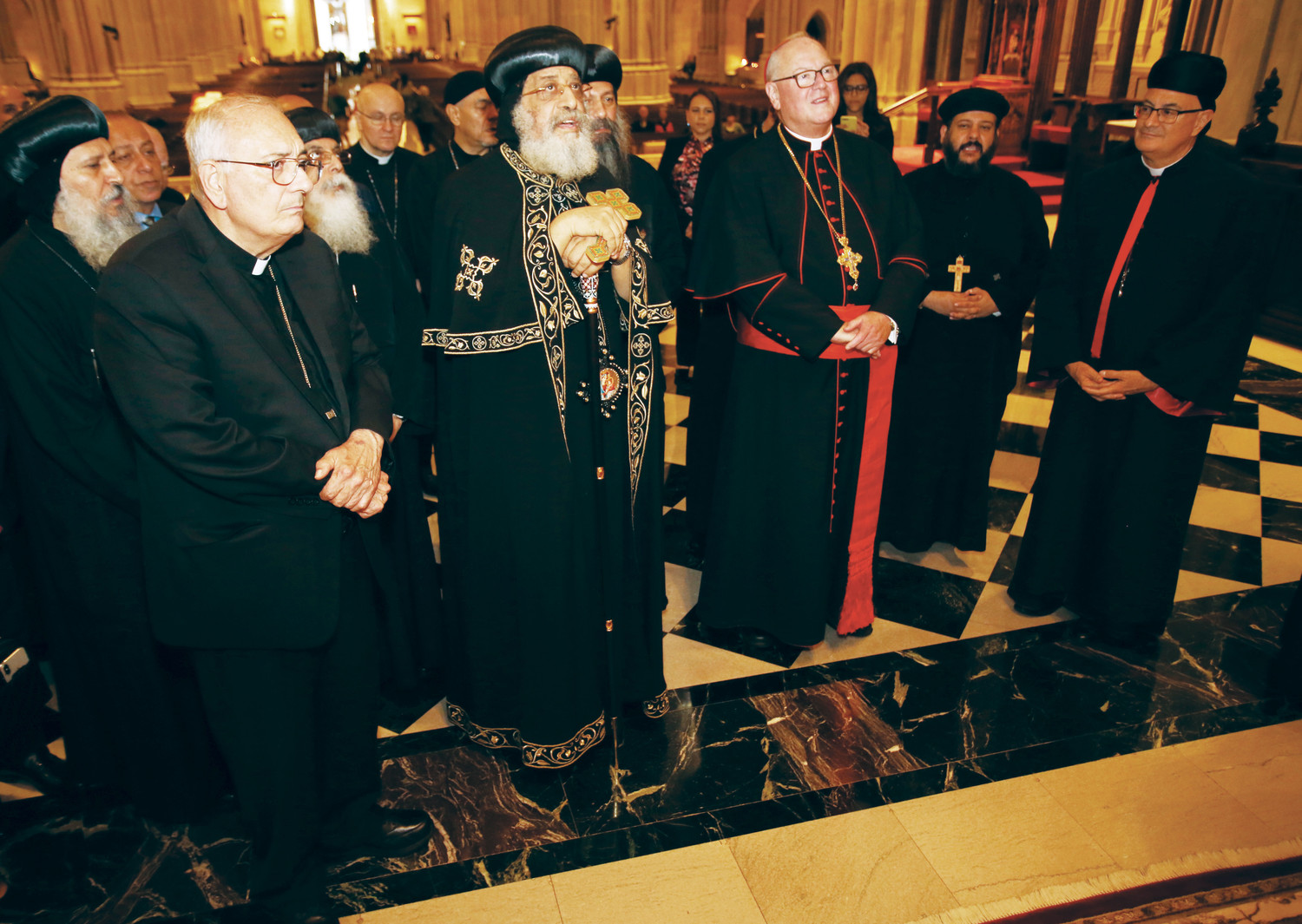 Pope Tawadros and Cardinal Dolan pray in the sanctuary of St. Patrick's Cathedral along with other prelates, including Bishop Nicholas DiMarzio of Brooklyn, left, and Bishop Gregory Mansour of the Eparchy of St. Maron of Brooklyn, right.