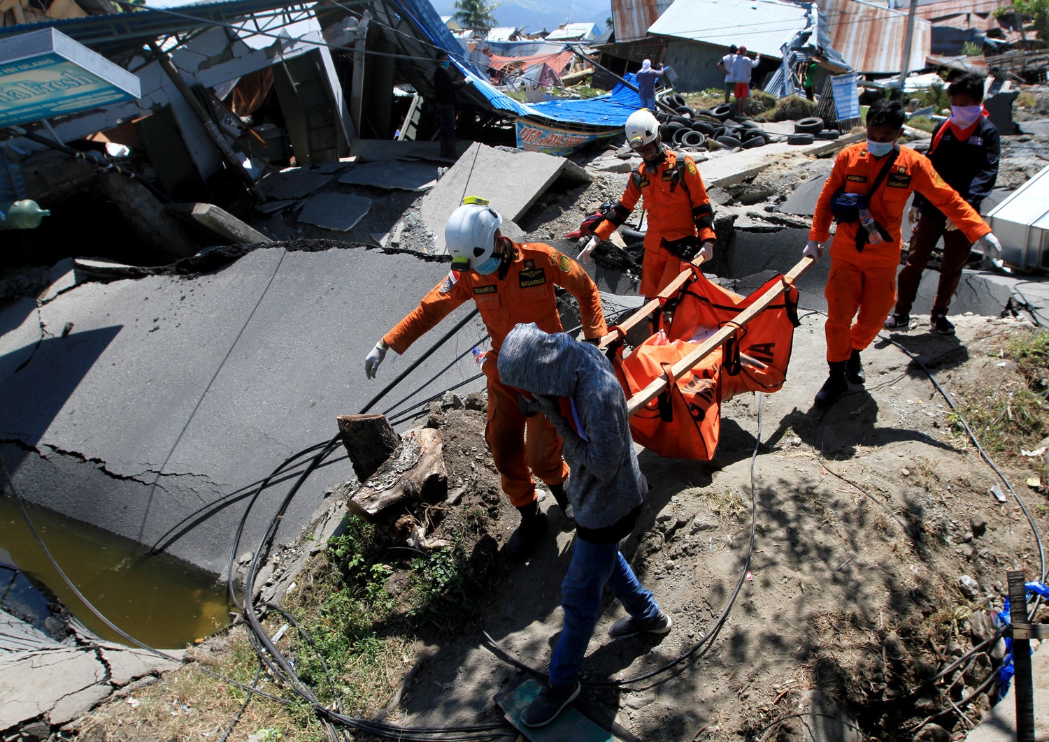 Indonesian rescue carry the body of a victim Oct. 1 after an earthquake and tsunami on Indonesia's Sulawesi Island.