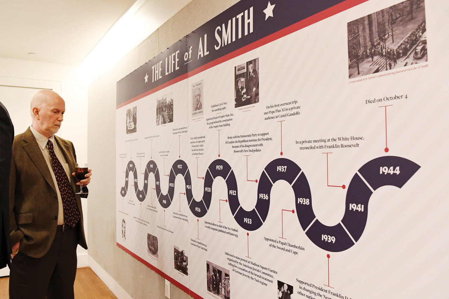A guest looks at a special pop-up exhibit at the Sheen Center following the panel discussion.