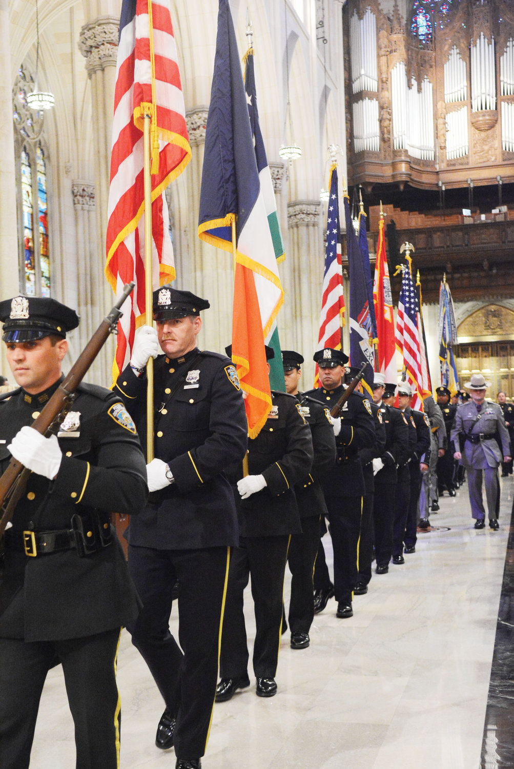 An NYPD honor guard leads the entrance procession.