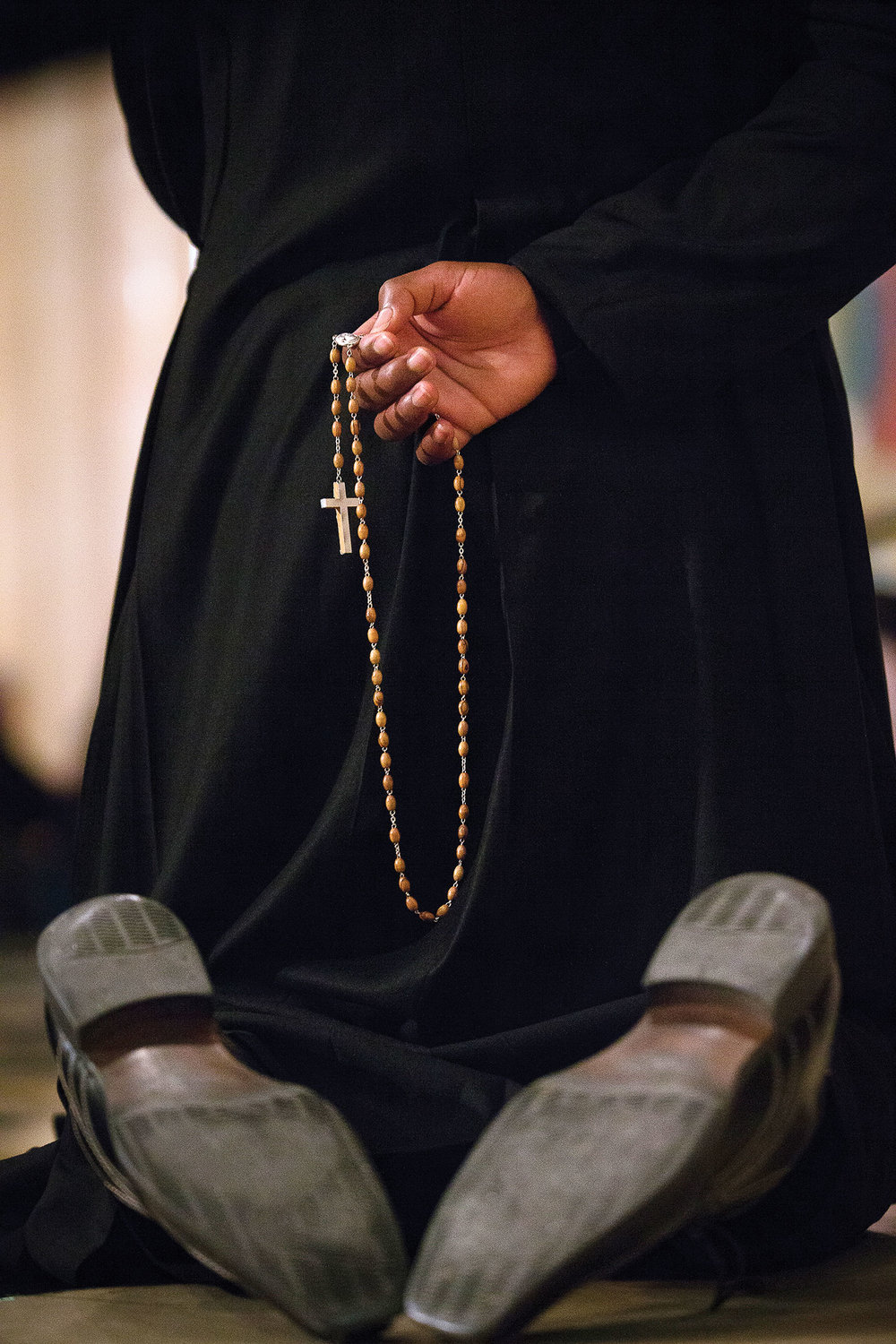 Seminarian Collins Ashu from St. Lucy's parish in the Bronx prays the Rosary.
