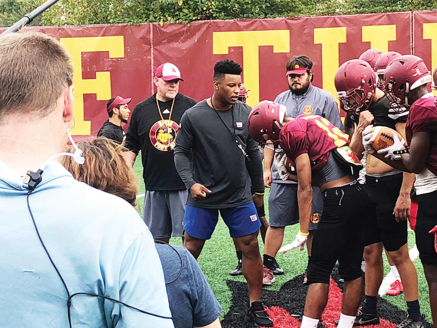 New York Giants rookie running back Saquon Barkley works with Cardinal Hayes High School football players at practice in the Bronx Oct. 2.