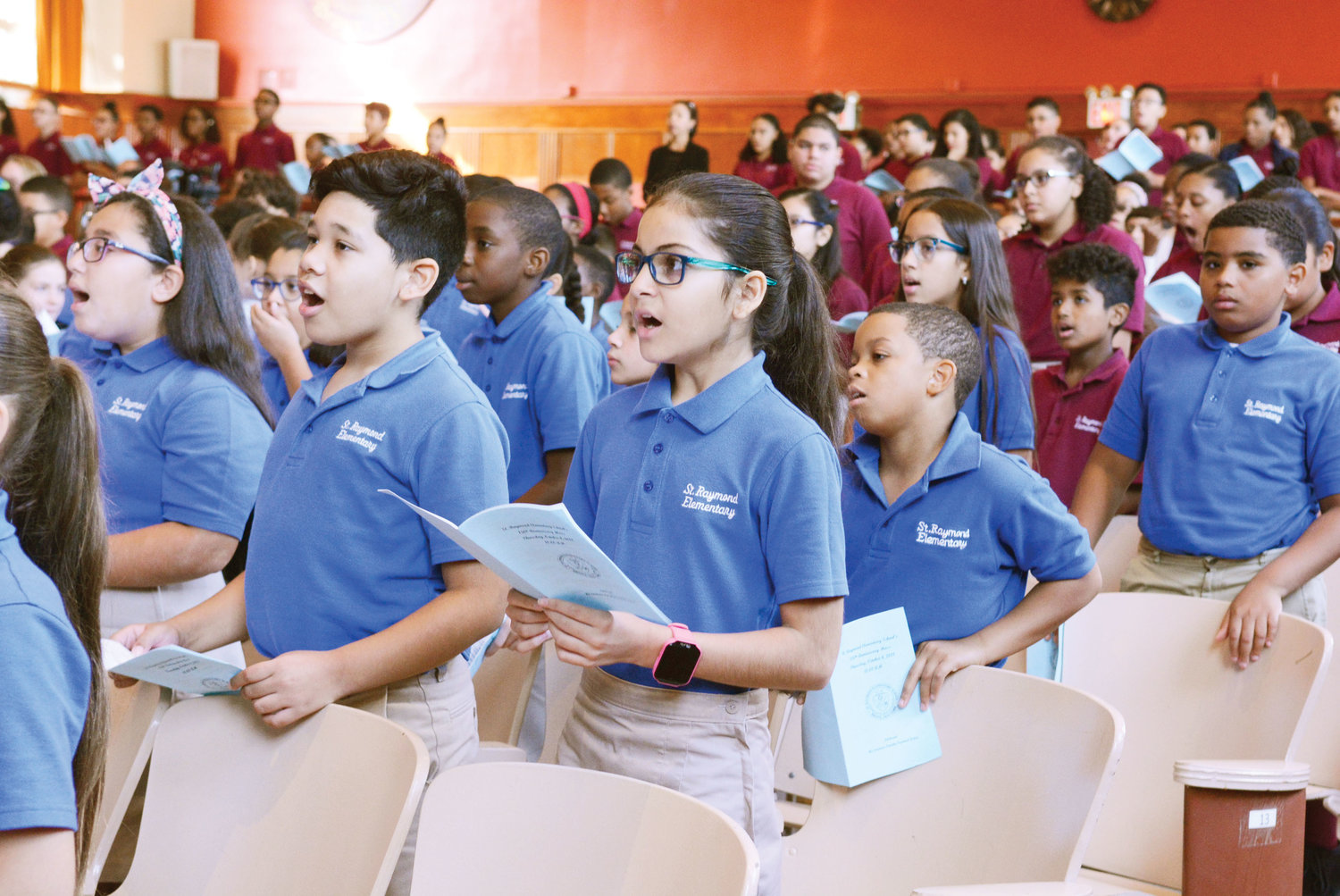 Students sing at Mass.