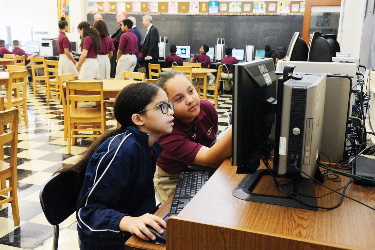 Sixth-graders Laisha Taveras and Adriana Acevedo, left to right, concentrate on a computer lesson.