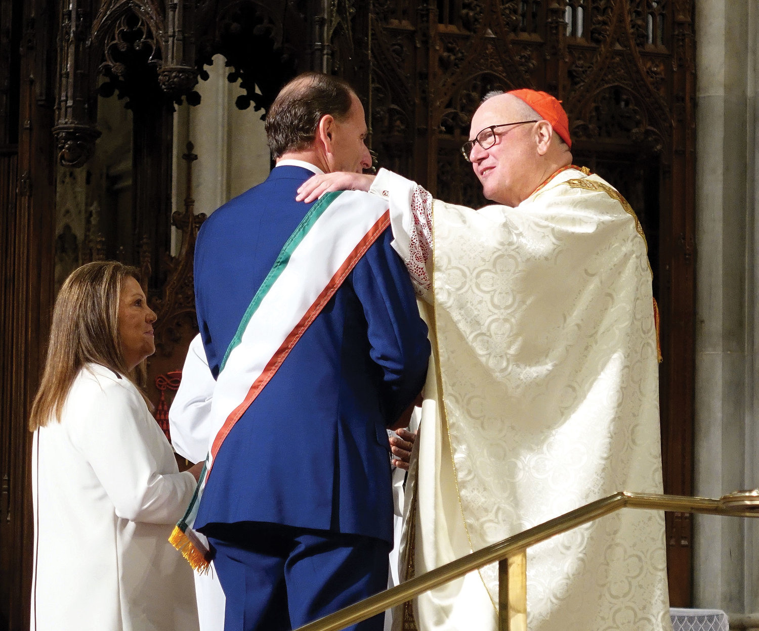 Cardinal Dolan greets Grand Marshal Guy Chiarello, president of First Data Corp., at the 41st annual Columbus Day Mass at St. Patrick's Cathedral.