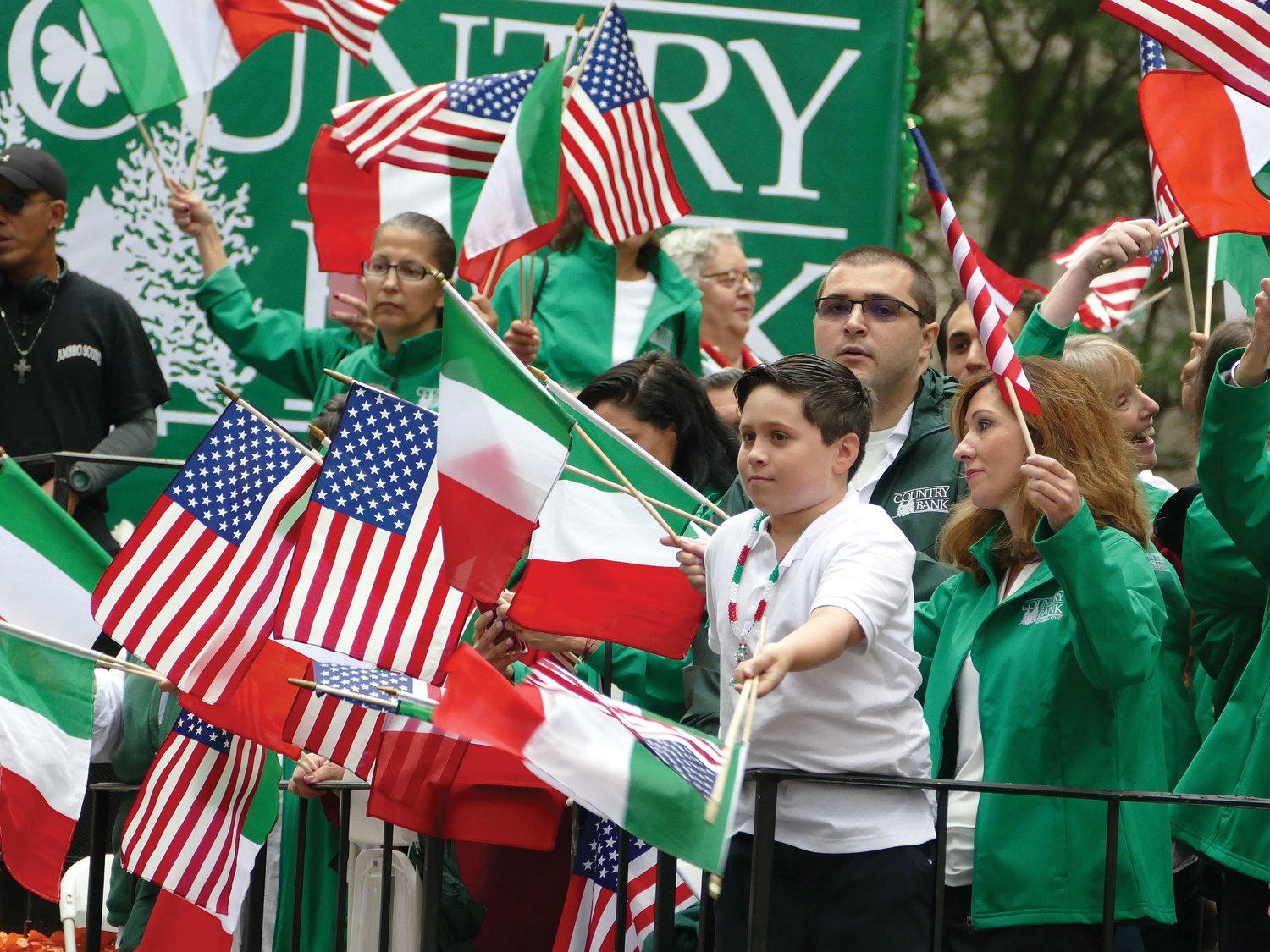 People wave Italian and American flags aboard one of the floats in the 74th annual Columbus Day Parade on Fifth Avenue in Manhattan Oct. 8.