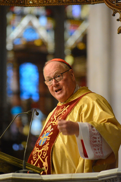 HOUSES OF GOD—The cardinal delivers the homily at the Guardian Mass from the pulpit of St. Patrick's Cathedral Oct. 1.
