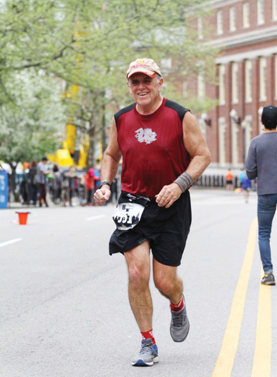 Archdiocesan employee Jim Mahony stays on course during a marathon in Providence, R.I., in May. Mahony, who ran his first New York City Marathon in 1981, has crossed the finish line of each race since then.