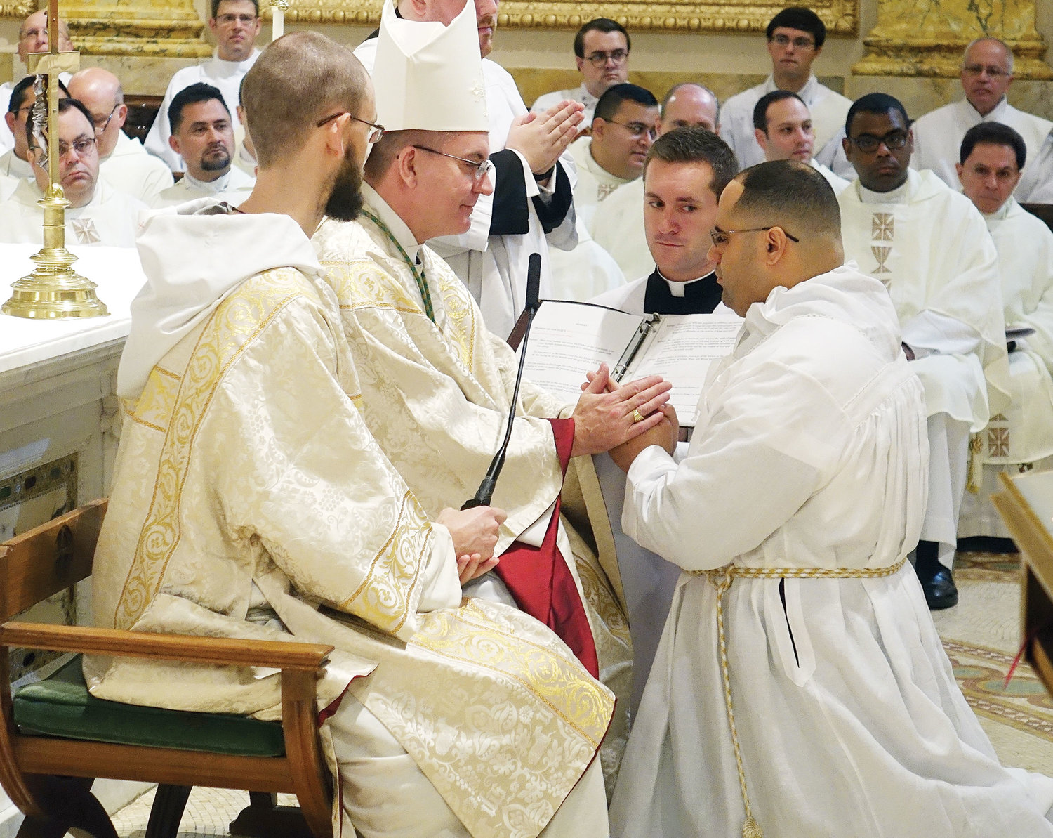 Bishop John O. Barres of Rockville Centre, the ordaining prelate, accepts a promise of obedience from Deacon John Figueroa during the Rite of Ordination.