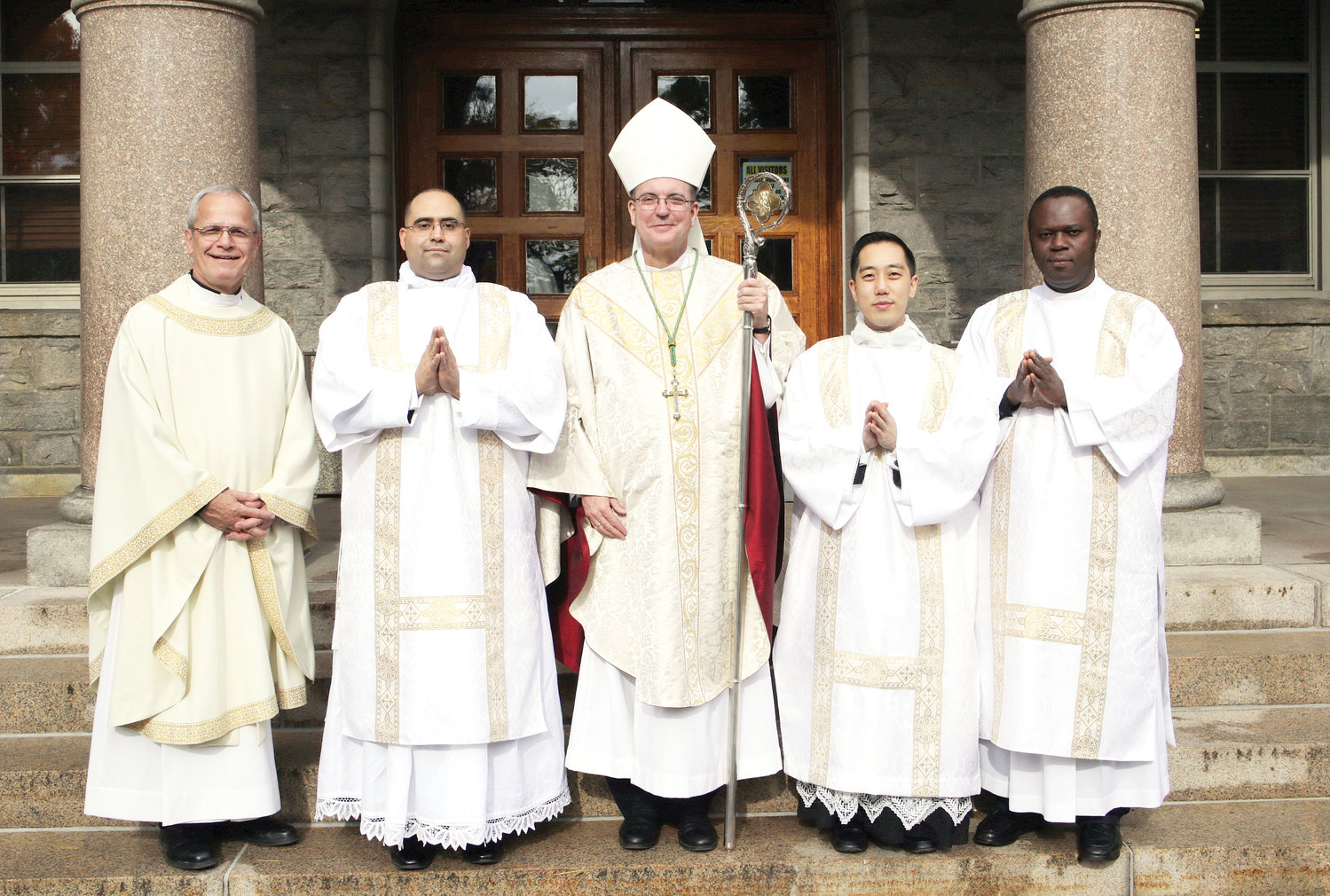 Joining Bishop John O. Barres of the Diocese of Rockville Centre, the principal celebrant, and Msgr. Peter Vaccari, rector of St. Joseph's Seminary, are Deacon John Figueroa, Deacon Roger Kwan and Deacon Joseph Akunaeziri.