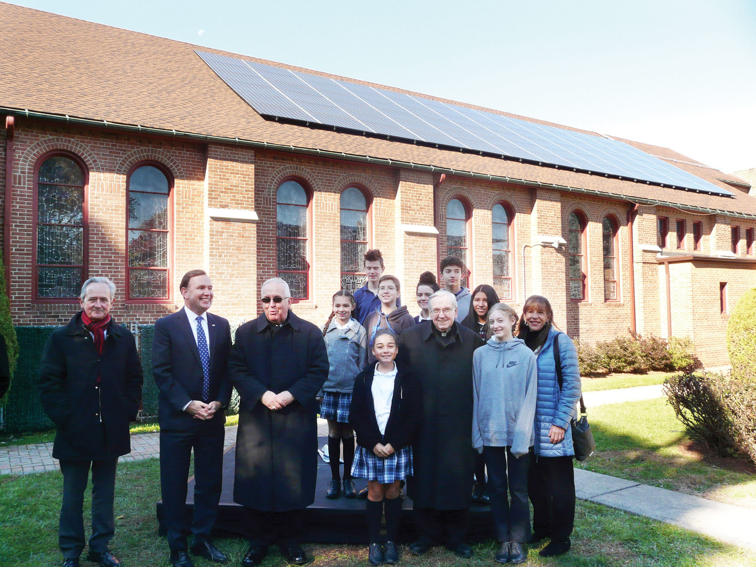 Joining Auxiliary Bishop John O'Hara, third from left, and Msgr. Peter Finn, administrator of Blessed Sacrament parish, along with eighth-graders from Blessed Sacrament School, were Martin Susz, director of energy management for the archdiocese, far left, and New York State Assembly member Michael Cusick.