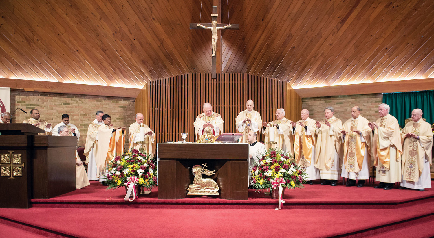 Cardinal Dolan celebrates Mass with Msgr. Francis McAree and other concelebrants Oct. 27 in the parish church, which marked its 50th anniversary this year.