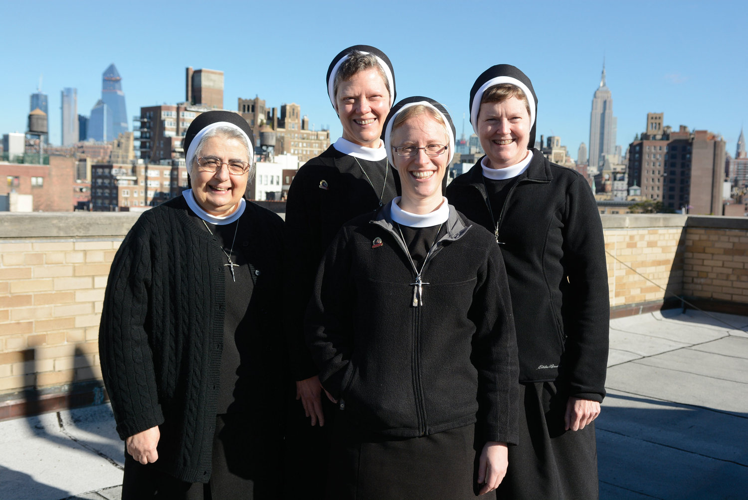 Sister Rita Marie Milano, A.S.C.J., Sister Colleen Therese Smith, A.S.C.J., Sister Bridget Mary Smith, A.S.C.J. and, in front, Sister Kathryn Press, A.S.C.J. The sisters assembled on the rooftop of Our Lady of Pompeii Convent and School in Manhattan Oct. 30.