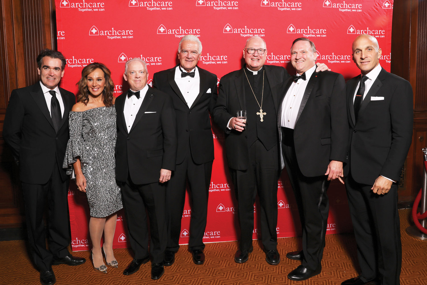 Cardinal Dolan greets Brian d'Arcy James, actor and musician; Rosanna Scotto, co-host of FOX5's Good Day New York; Scott LaRue, president and CEO of ArchCare; Dr. Anthony Bacchi, M.D., founder and CEO of TeliStat; Steve Schott, principal of CapTrust Financial Advisors; and Pete Bevacqua, president of NBC Sports Group, at the ArchCare Gala Oct. 25. Dr. Bacchi and Schott were honored for their support of ArchCare, the archdiocese's health care system.