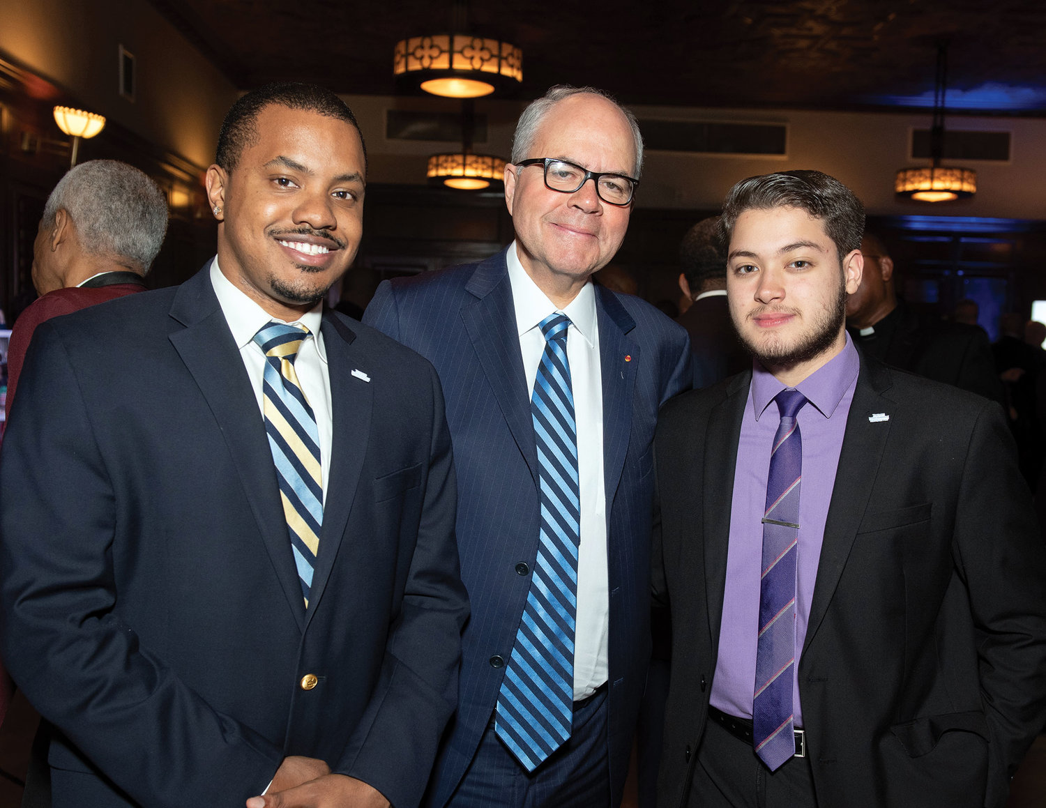 The other honoree was Peter James Johnson Jr., president of Leahey & Johnson, P.C. Johnson, center, is flanked by Samuel Riddick, left, a past recipient of the college scholarship award, and Abdul Mustafa, a current recipient.