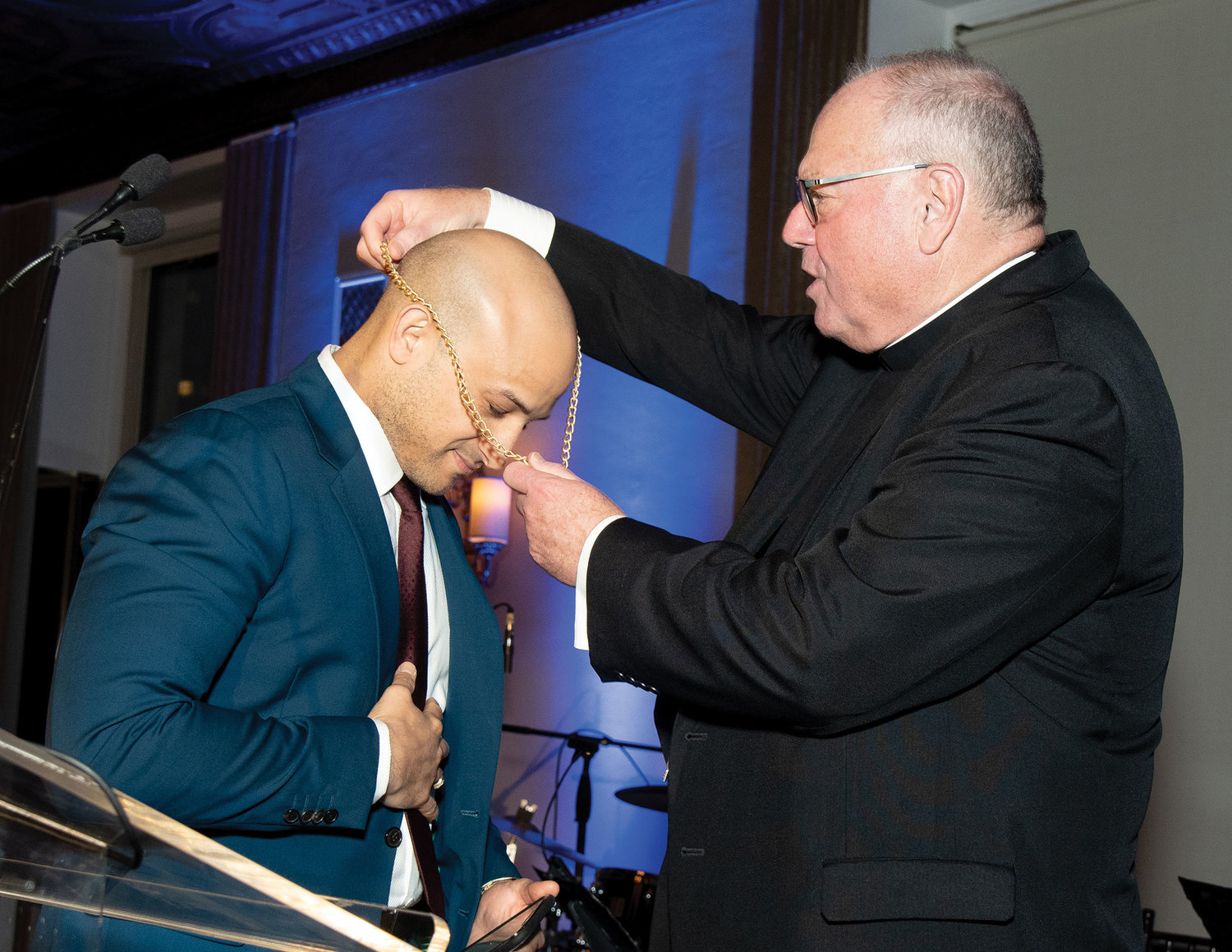Cardinal Dolan bestows the Pierre Toussaint Award medallion on Dr. Paul Tallaj, the son of honoree Dr. Ramón Tallaj, who was unable to attend. Dr. Ramón is chairman of the board, SOMOS Community Care, Manhattan.