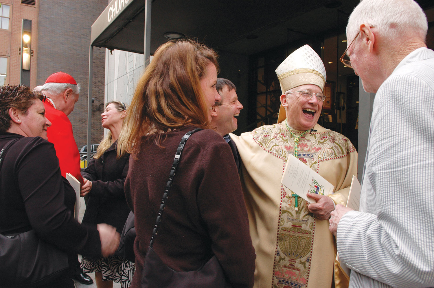 The bishop greeted friends and parishioners after a Mass at St. John the Evangelist Church in May 2007 celebrating his 50th anniversary as a priest and 10th anniversary as a bishop.