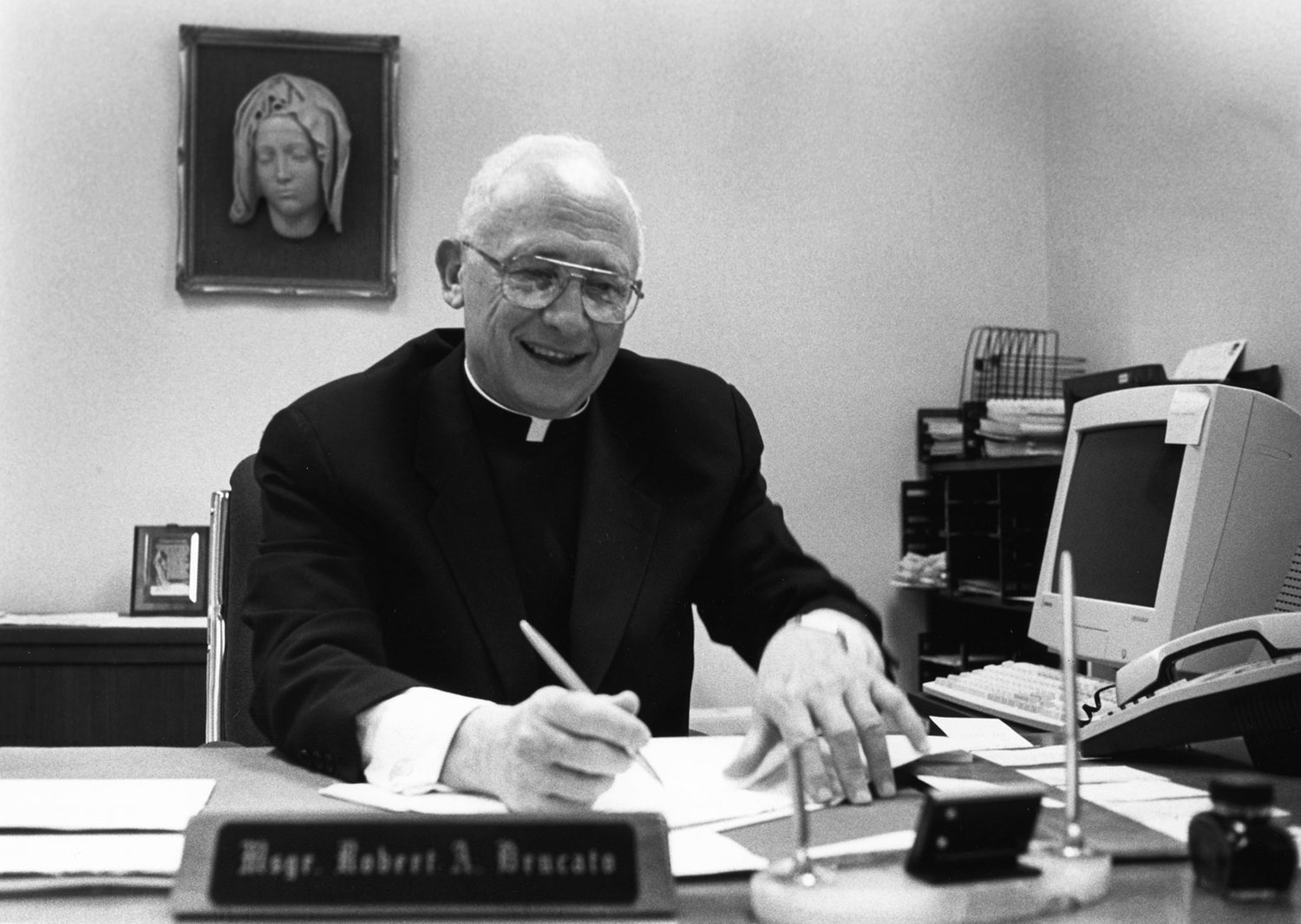 Bishop-designate Brucato at his desk shortly after his appointment as an auxiliary bishop was announced in July 1997.