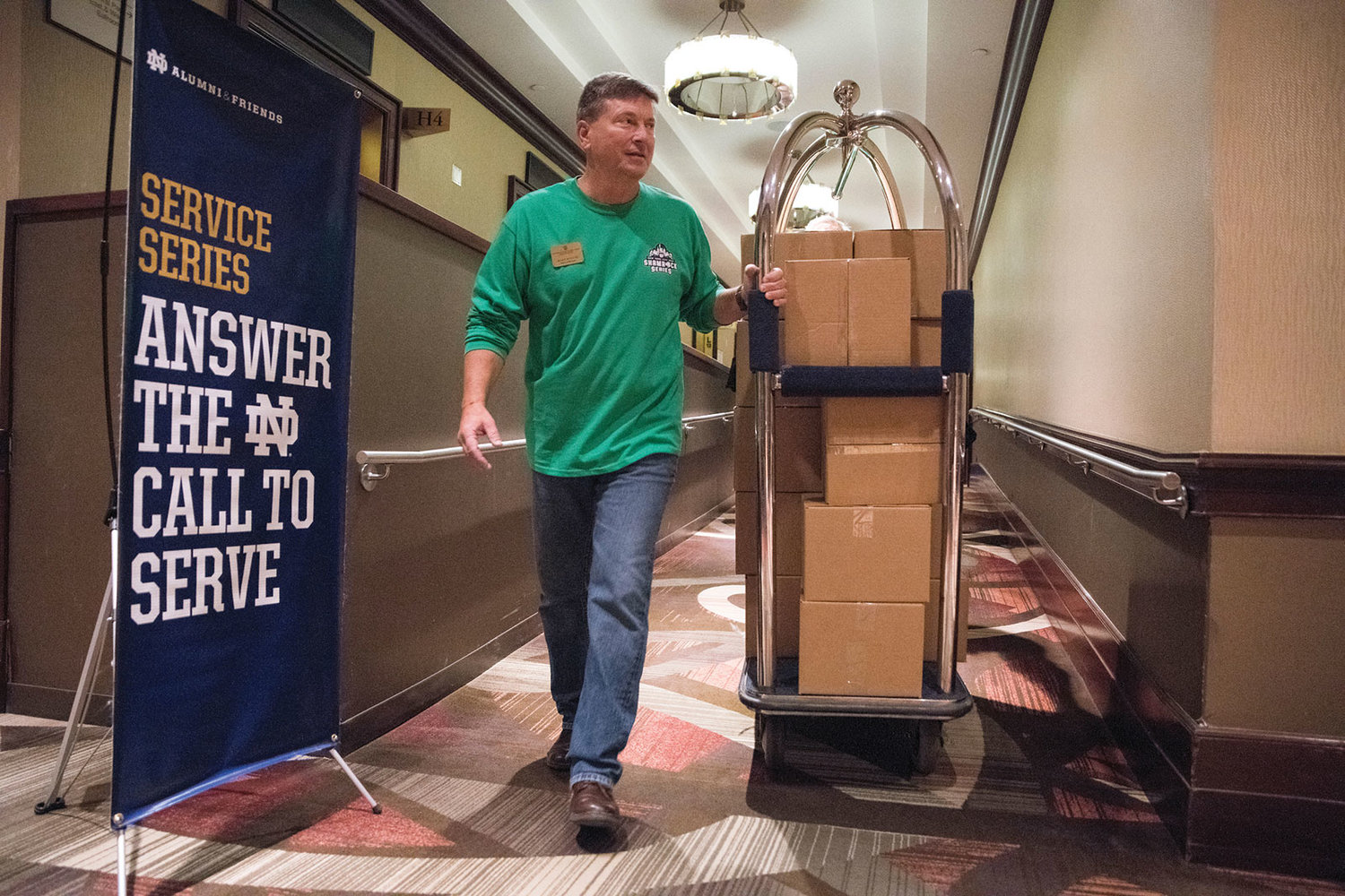 Mark Witucki, business manager of the Notre Dame Alumni Association, pulls a cart with Thanksgiving meal boxes at the Sheraton New York in Manhattan Nov. 16. Notre Dame alumni and friends packed the Thanksgiving meal boxes as part of the association's service project during a visit to New York.