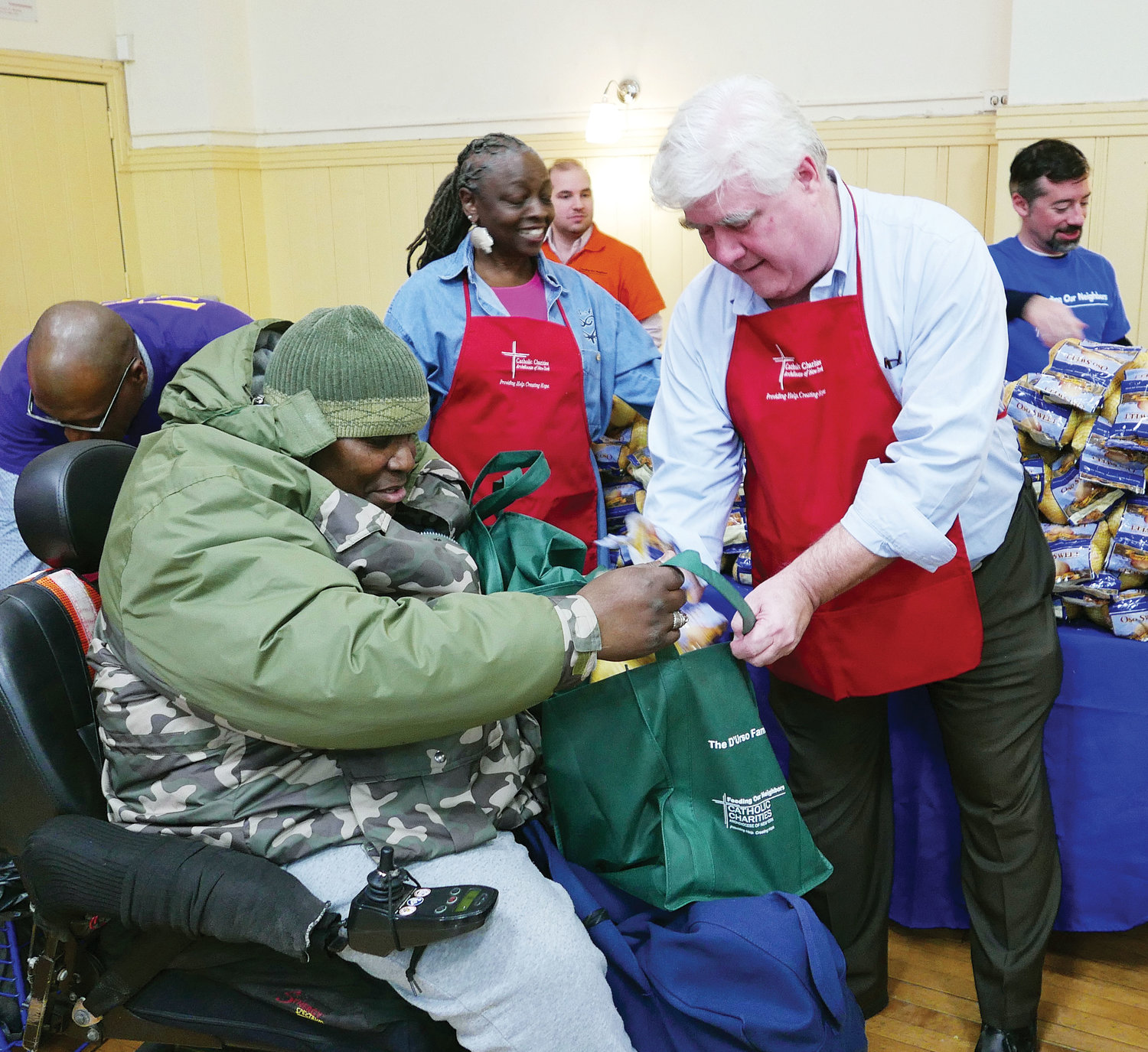 Volunteer Phil Whalen hands out Thanksgiving vegetables.