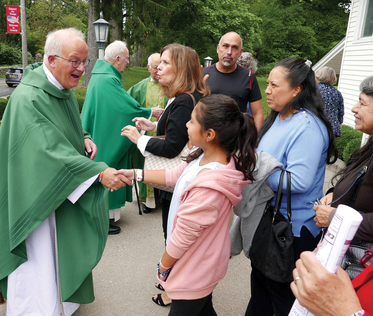 Father Kent Wilson greets parishioners after the Mass.